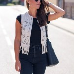 Ripped Jeans and Fringe Vest